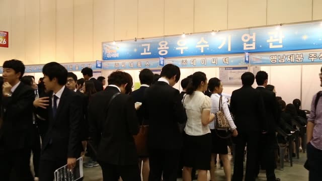 job seekers are interviewed by prospective employers during a job fair at the busan exhibition and convention center in busan job seekers wait in... - unemployment application stock videos & royalty-free footage