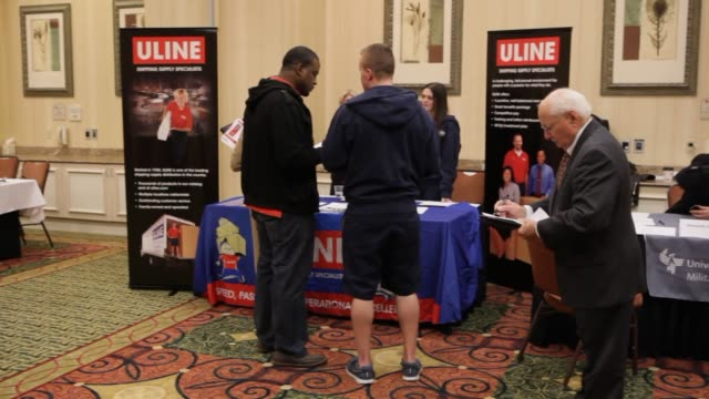 Job seekers at a job fair hosted by JobExpocom in Dallas Texas US on Wednesday Jan 29 Wide shot Wide shot of job seekers speaking to representatives...