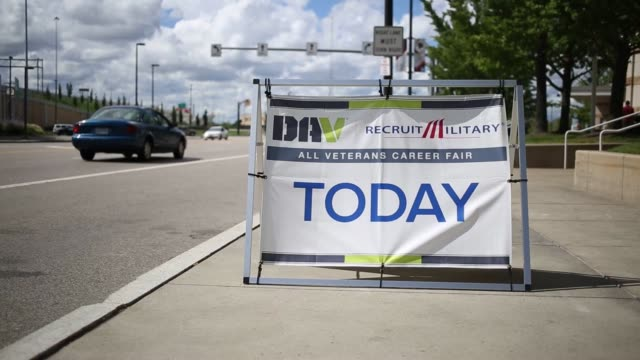 stockvideo's en b-roll-footage met job seekers at a recruit military veterans job fair at progressive field in cleveland, ohio, u.s., on thursday, september 1, 2016. shots: shot of man... - military recruit
