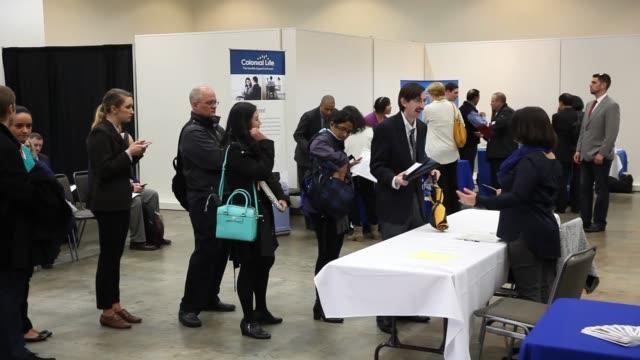 vídeos y material grabado en eventos de stock de job seekers attend a career fair at the seattle center pavilion in seattle washington on january 28th 2016 photographer michael kanebloomberg shots... - feria de trabajo