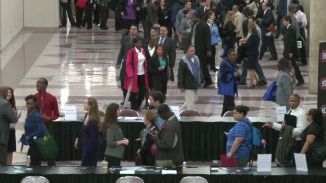 Job seekers file into the main hall of the Job Fair MS of the moving lines wrapping around the atrium leading to the hall MS of the entrance to the...