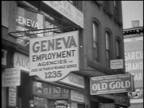 job seekers lining up at employment agencies / united states - anno 1934 video stock e b–roll