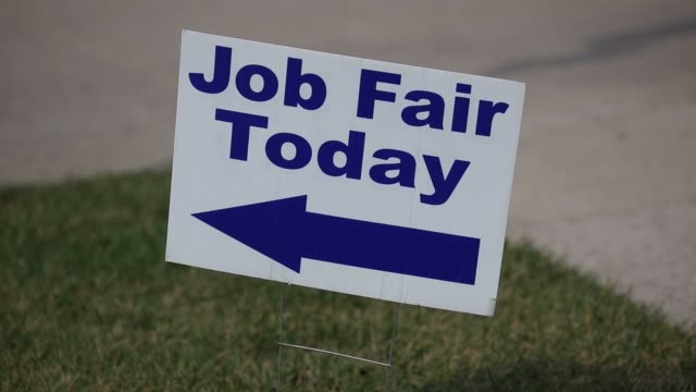 Job seekers meet with potential employers at a Job News USA career fair in Overland Park Kansas US on Wednesday March 8 2017 Shots shot of walking...