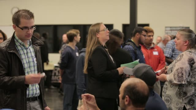 job seekers meet with recruiters specifically geared toward those seeking aerospace maritime and manufacturing positions at south seattle college in... - leaning stock videos & royalty-free footage