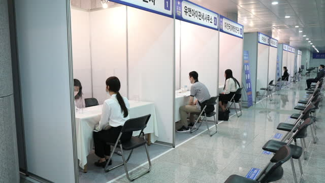 job seekers participate in on-site interviews at the booths of the participating companies during a job fair for the youths organized by the seongnam... - employee engagement stock videos & royalty-free footage