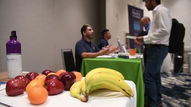 Job seekers speak to job recruiters during the Coast to Coast job fair in San Jose California US on Wednesday July 19 2017 Shots shot of job seekers...