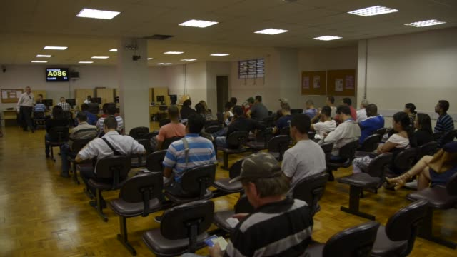 job seekers speak with associates at cat centro de apoio ao trabalho sao paulo brazil on august 31st 2015 shots wide shots of job seekers sitting at... - trabalho no comércio stock videos & royalty-free footage