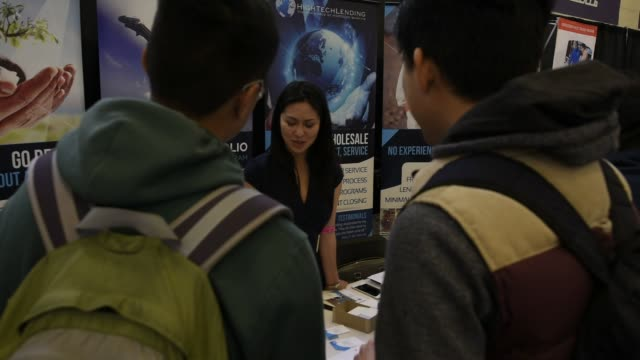 Job seekers speak with recruiters at the Spring Career Fair at San Francisco State University in California US on April 3rd 2015 Shots Close up shots...