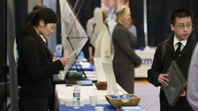 Job seekers speak with recruiters at the Spring Career Fair at San Francisco State University in California US on April 3rd 2015 Shots Wide shot of...