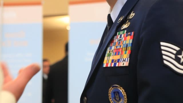 "stockvideo's en b-roll-footage met ""job seekers speak with representatives at the recruit military veteran job fair in san diego, california, u.s.information is available at the front... - military recruit"
