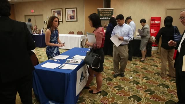 job seekers wait in line to speak with representatives during a choice career fair in los angeles, california, us, on wednesday, june 22, 2016 shots:... - hand of cards stock videos & royalty-free footage