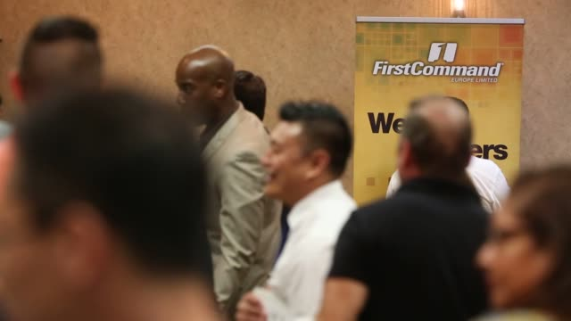 job seekers wait in line to speak with representatives during a choice career fair in los angeles, california, us, on wednesday, june 22, 2016 shots:... - 就職フェア点の映像素材/bロール