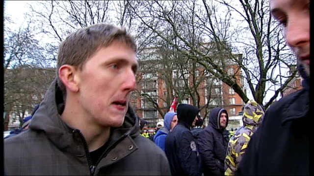 jobbik party supporters at hyde park: gabor vona arrival; england: london: hyde park: ext anti-fascist protesters chanting 'jobbik scum, off our... - ungarische kultur stock-videos und b-roll-filmmaterial