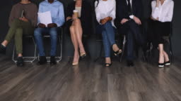 Jobless multiracial different ages applicant waiting for job interview.