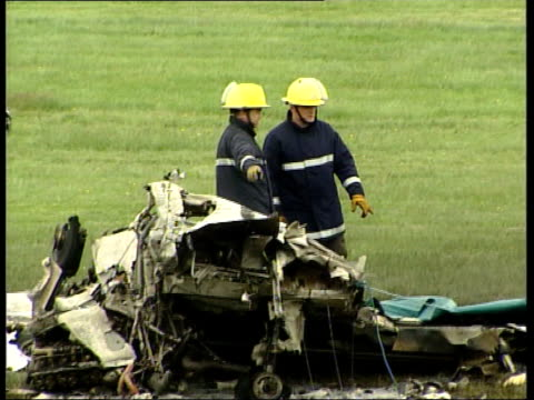 Latest LIB Cambridgeshire Newmarket Firemen looking at wreckage of aircraft