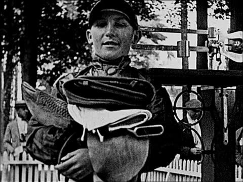 jockey displaying the sweater heavy underwear and rubber suit he uses to loose weight before a race / jockey weighed before race - scales stock videos & royalty-free footage