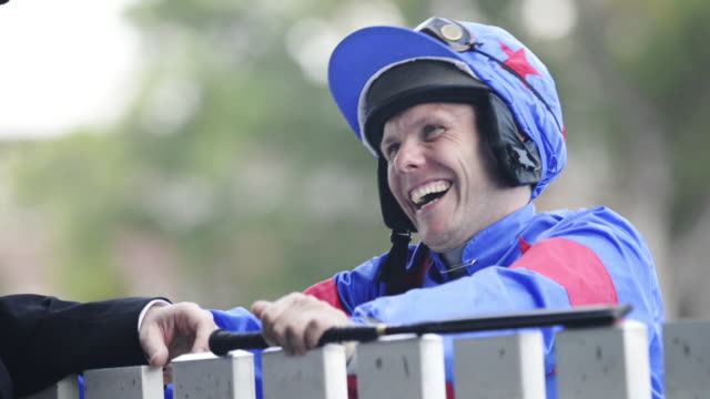 Jockey Laughing