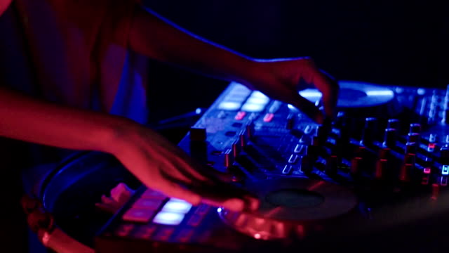 dj jockey mixing music at night club - setting stock videos & royalty-free footage