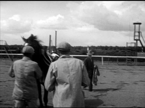 jockey ted atkinson on greentree stable 'hoodwink' getting off taking off saddle vs jockeys being weighed on outdoor scale testing dr jordan woodcot... - tag 2 stock-videos und b-roll-filmmaterial