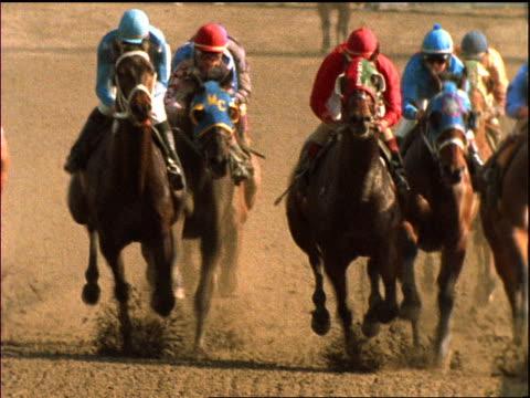 jockeys on horses racing past camera - jockey stock videos & royalty-free footage