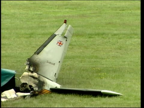 newmarket wreckage of light plane which crashed onto newmarket racecourse shortly after take off with firefighters standing next ms tail fin of plane... - newmarket suffolk england stock videos and b-roll footage