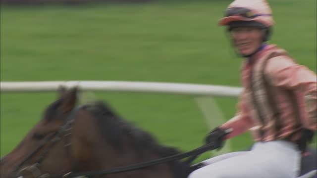 MS Jockeys riding on horses before race at Newbury Racecourse / Newbury, England, UK