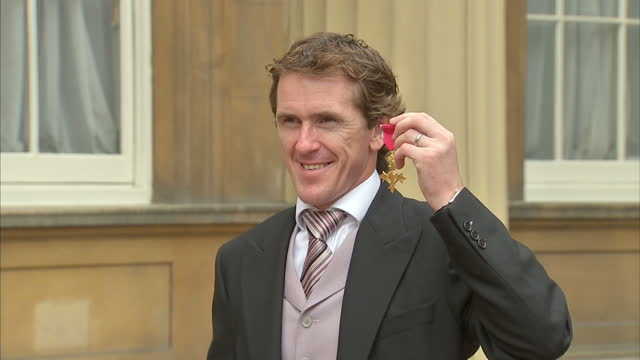 jocky tony mccoy poses with obe with wife chanelle and daughter eve tony mccoy poses with his obe on june 29 2011 in london england - order of the british empire stock videos and b-roll footage