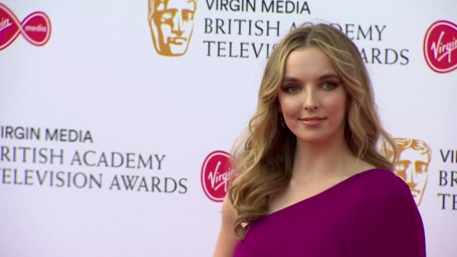 jodie comer poses for photos on red carpet at bafta tv awards 2019 at royal festival hall london - british academy television awards stock videos & royalty-free footage