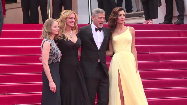 Jodie Fosters Money Monster starring Julia Roberts George Clooney and Dominic West premiered at the Cannes Film Festival on Thursday where the...