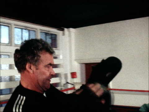 joe awome training; b) nao england: london: highgate: int joe awome shadow boxing cms side awome sparring with trainer, george francis joe awome... - highgate stock videos & royalty-free footage