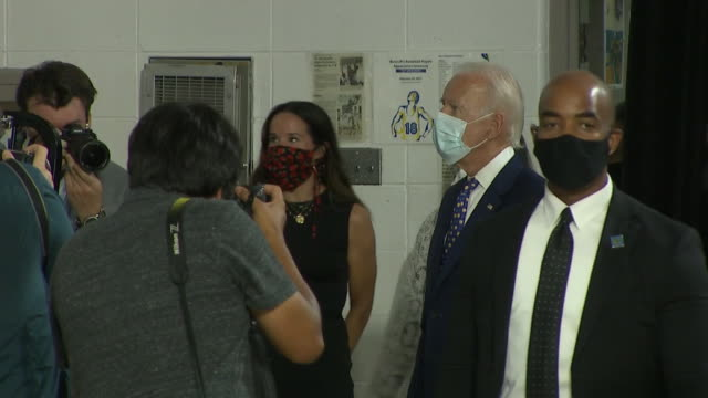 """joe biden puts on a mask and gets ready to leave after delivering remarks at the """"build back better economic equity"""" campaign briefing in wilmington,... - healthcare and medicine or illness or food and drink or fitness or exercise or wellbeing stock videos & royalty-free footage"""