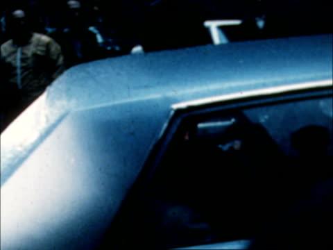 joe colombo shooting; library shots from usa: new york: joe colombo escorted l - r cms colombo in car criminal court building int joe colombo... - joe 03 stock videos & royalty-free footage