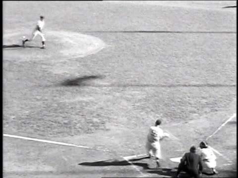 vídeos de stock, filmes e b-roll de joe dimaggio hits a home run in game 2 of the 1951 world series between the yankees and giants / new york city, new york, united states - 1951