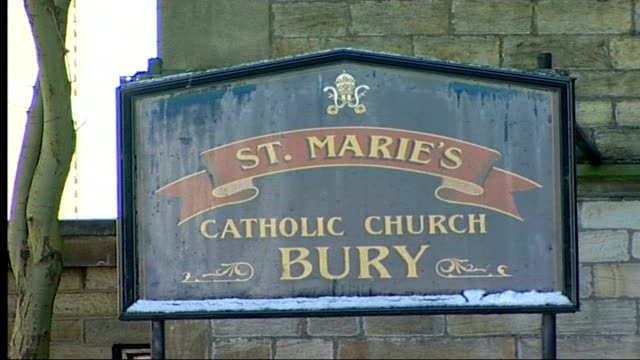 parents' tribute ext people outside st mary's catholic church tilt close up of st mary's catholic church sign low angle shot of church spire couple... - spire stock videos & royalty-free footage