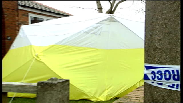 youth found guilty of murder; tx march 2006 bury: ext police officer and forensic tent outside house where joe geeling was murdered forensic officers... - searching点の映像素材/bロール