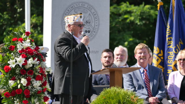 joe hardin commander of vfw post 604 speaks during memorial day ceremonies at valhalla memory gardens may 29 2017 in bloomington ind a new war... - veterans of foreign wars of the united states stock videos & royalty-free footage