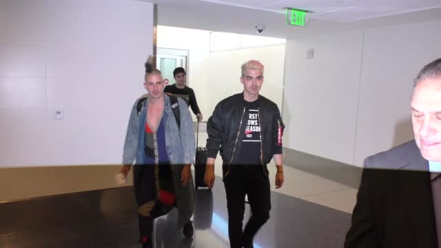 joe jonas & cole whittle talk about hairstyles while departing at lax airport in los angeles in celebrity sightings in los angeles, - joe 03 stock videos & royalty-free footage