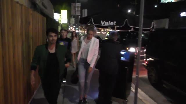 joe jonas & gigi hadid at nobu restaurant & nice guy nightclub in hollywood in celebrity sightings in los angeles, - ジジ・ハディッド点の映像素材/bロール
