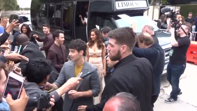 joe jonas kevin jonas nick jonas priyanka chopra greet fans outside the chasing happiness premiere at regency bruin theatre in westwood in celebrity... - bruin theater stock videos & royalty-free footage