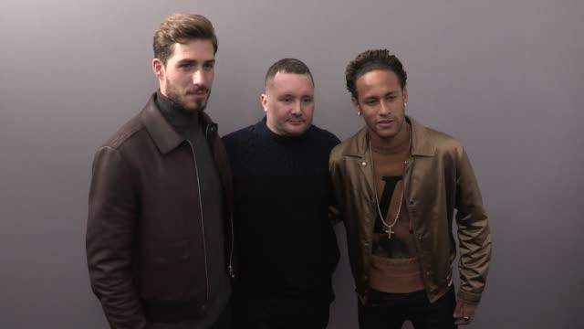 Joe Jonas Neymar Jr Kevin Trapp Will Peltz and Gwendoline Christie greet designer Kim Jones backstage of his last Louis Vuitton Menswear Fashion show...