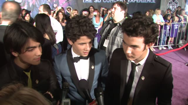 joe jonas, nick jonas, and kevin jonas on making a 3d movie, on having fans in the white house, on performing for the obama's, on which one of them... - 2009 stock videos & royalty-free footage