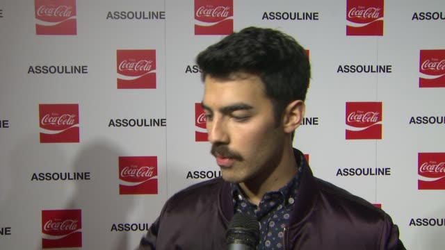INTERVIEW Joe Jonas on CocaCola at the Assouline and Memoire Set CocaCola Music Sports launch event in Los Angeles California on 12/05/13