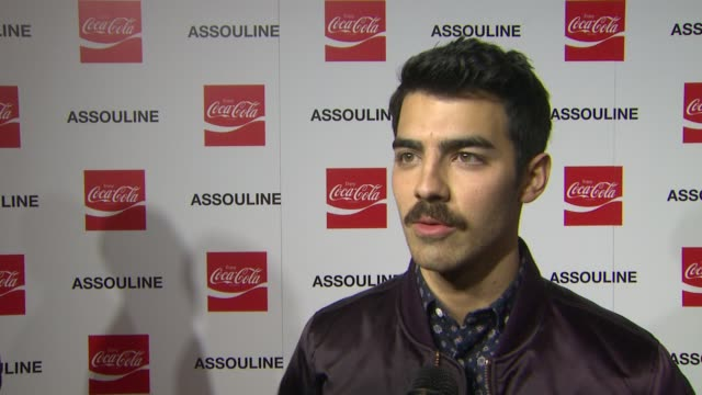 INTERVIEW Joe Jonas on Nelson Mandela at the Assouline and Memoire Set CocaCola Music Sports launch event in Los Angeles California on 12/05/13
