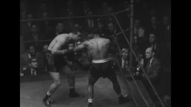 joe louis and bob foxworth boxing in the ring in chicago during exhibition fight / they punch and jab each other / louis gets foxworth on the ropes /... - boxing ring stock videos & royalty-free footage