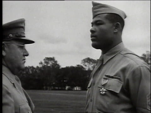 joe louis being decorated with the legion of merit award for touring gi camps during wwii / united states - militäruniform stock-videos und b-roll-filmmaterial