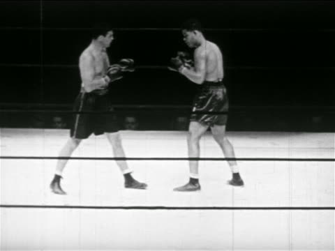 stockvideo's en b-roll-footage met joe louis james braddock boxing while referee watches - 1937