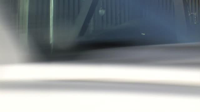 vídeos y material grabado en eventos de stock de joe louis sculpture of fist hanging on display mi downtown boxer joe louis barrow the brown bomber - puño gesticular