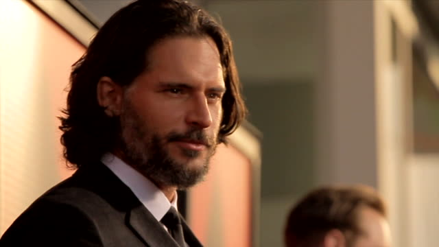 joe manganiello posing for paparazzi on the red carpet at the arclight cinemas cinerama dome - シネラマドーム点の映像素材/bロール