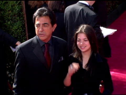 Joe Mantegna and guest at the 2006 Primetime Emmy Awards arrivals at the Shrine Auditorium in Los Angeles California on September 19 2004