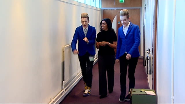 Joe McElderry wins 'The XFactor' John and Edward Grimes along corridor with reporter and interview SOT